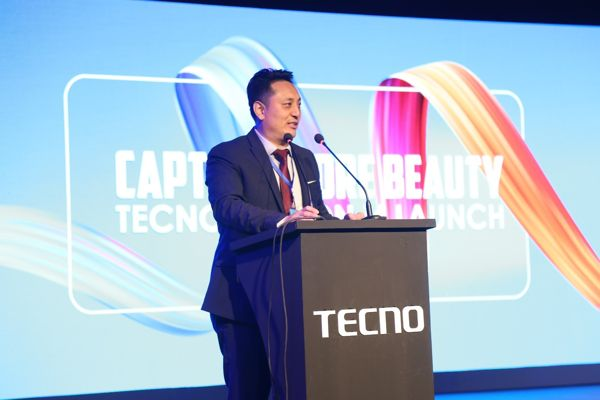 Higer Zhao addressing the event